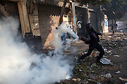 Egyptian police clashed with anti-government protesters for a fifth day in central Cairo Wednesday as a rights group raised the overall death toll from the ongoing unrest to 38..The clashes came one day after tens of thousands of protesters in Tahrir Square rejected a promise by Egypt's military ruler to speed up a presidential election to the first half of next year. (Photo by Heidi Levine/Sipa Press).