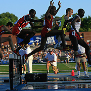 13 JUNE 2008:  Competitors in the Men's 3,000 meter steeple chase clear the first water jump at the NCAA Division 1 Men's and Women's Track & Field Championships in Des Moines, Iowa.  David Peterson