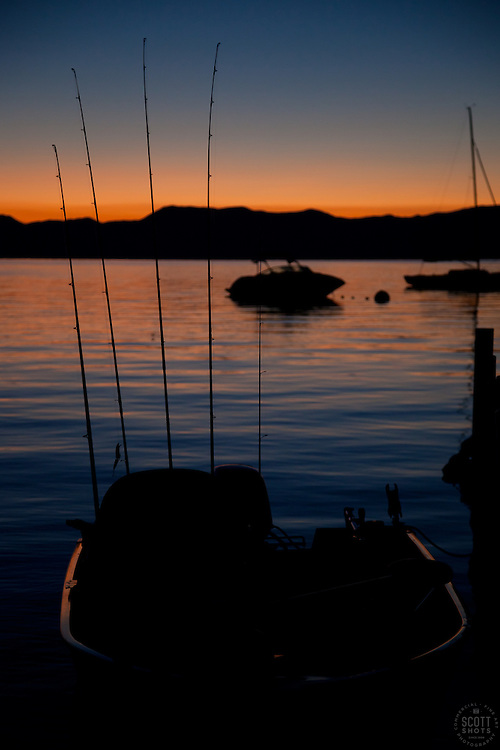 """""""Tahoe Fishing Boat at Sunrise"""" - This silhouette of a fishing boat and fishing poles was photographed at sunrise on Lake Tahoe."""