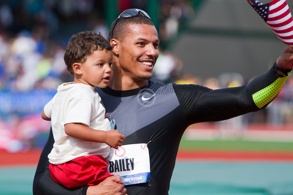Ryan Bailey clelbrates making USA Olympic team on victory lap with son Tyree