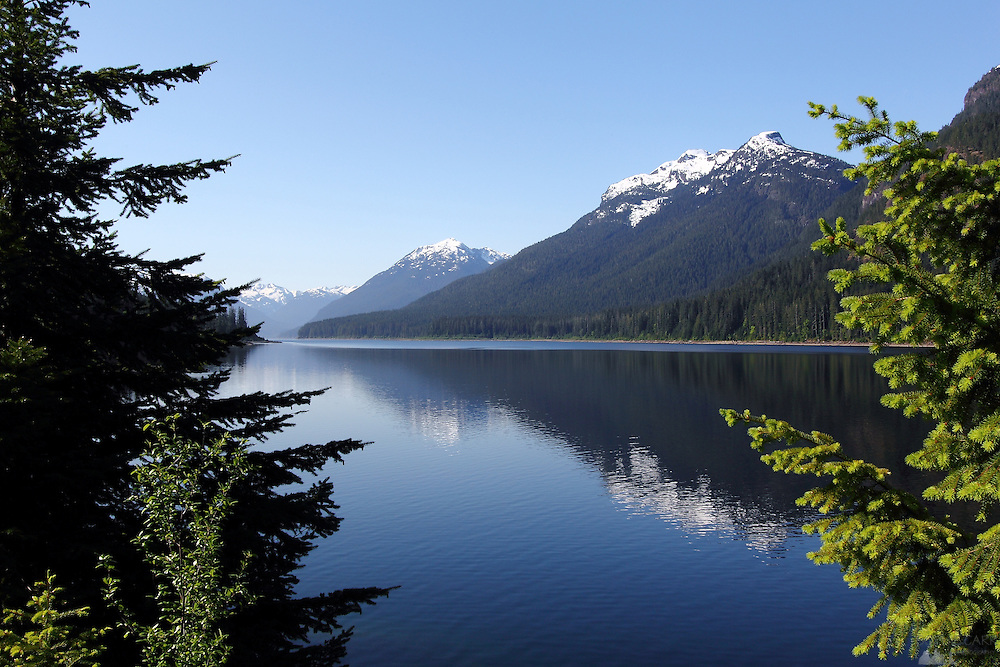 Reflections and perfect weather on Buttle Lake, Strathcona Provincial Park, Vancouver Island, British Columbia, Canada