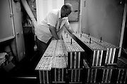 A mechanic organises the stock pile of rods ready to be installed onto the planes as soon as they return from seeding clouds. Image © Angelos Giotopoulos/Falcon Photo Agency