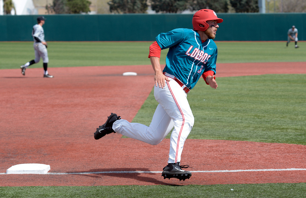 gbs032217aa/SPORTS -- UNM's Carl Stajduhar rounds third base and scores in the fourth inning of the game against Grand Canyon University at the Santa Ana Star Field on Wednesday, March 22, 2016. (Greg Sorber/Albuquerque Journal)