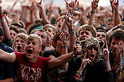 READING, ENGLAND - AUGUST 25:  Fans soak up the atmopshere as Enter Shikari perform live on the Main Stage on Day Two during the Reading Festival 2012 at Richfield Avenue on August 25, 2012 in Reading, England.  (Photo by Simone Joyner/WireImage)