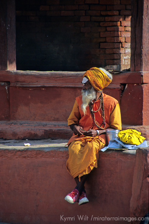 Asia, Nepal, Bhaktapur. A Sadhu in sneakers sits in Durbar Square, Bhaktapur.