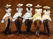 Women horse riders at Lienzo Charro charreada show, Guadalajara, Mexico.