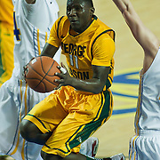 02/01/12 Newark DE: George Mason Sophomore Guard Vertrail Vaughns #11 sliver though the Delaware defense while attempting a lay up during a Colonial Athletic Association conference Basketball Game against Delaware Wed, Feb. 1, 2012 at the Bob Carpenter Center in Newark Delaware.