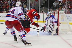 Sep 16, 2013; Newark, NJ, USA; New York Rangers goalie Cam Talbot (33) makes a save on a shot by New Jersey Devils center Rostislav Olesz (25) during the second period at Prudential Center.