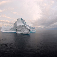 Icebergs from Greenland, drifting on Iceberg Alley. Baffin Bay.  Baffin Island. High Arctic. Canada&amp;#xA;( environment, global warming, ice, snow, white, blue, turquoise, inmense, mass, block, glacier, foggy, fog, ocean, arctic circle, winderness, view, trip, exploration, wild, scenic, scenics, seascape, tourist, cold, orlova, icebreaker, russian<br />