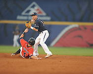 Ole Miss' Tim Ferguson is forced out vs. Auburn during the Southeastern Conference tournament at Regions Park in Hoover, Ala. on Friday, May 28, 2010.  (AP Photo/Oxford Eagle, Bruce Newman)