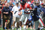 Ja-Mes Logan (85) is tackled by Nick Brassell (5) at Ole Miss' Grove Bowl at Vaught-Hemingway Stadium in Oxford, Miss. on Saturday, April 13, 2013.