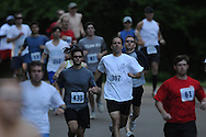 Runners race in the Doublke Decker 10K race on Sunday, April 25, 2010 in Oxford, Miss.