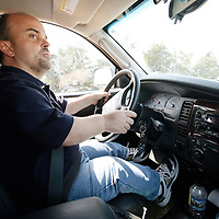 Chris Kotzian drives his car on a shopping trip in Thornton, Colorado March 25, 2010.  Chris, a little person, needs extensions on the gas pedal and brake as he is about 4-feet-tall. Chris is active in the Little People of America, the only dwarfism support organization that includes all 200+ forms of dwarfism.  REUTERS/Rick Wilking (UNITED STATES)