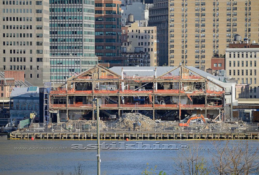 """Demolition of """"Pier 17"""" at South Street Seaport in Lower Manhattan, New York."""
