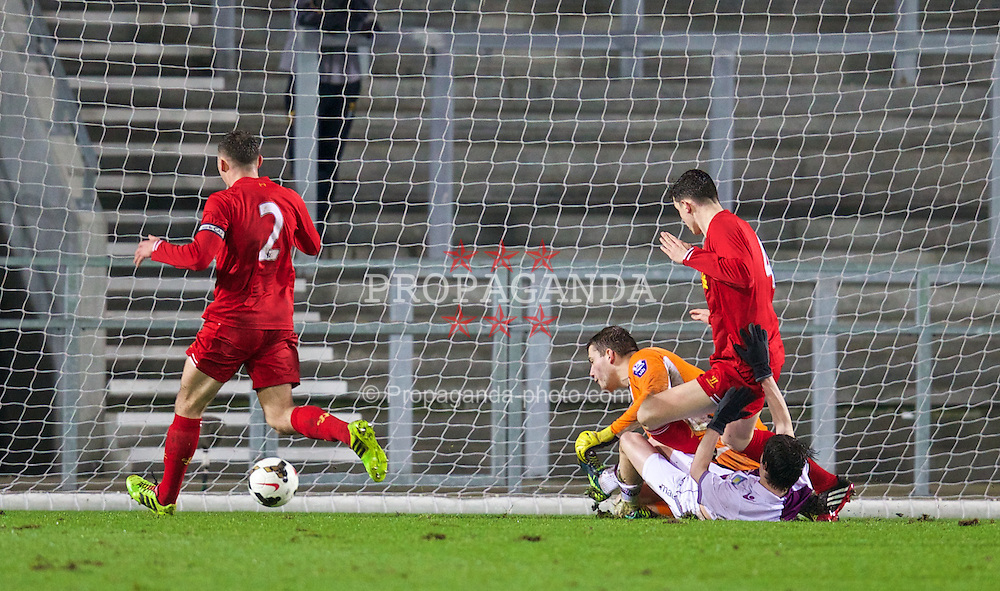 ST. HELENS, ENGLAND - Wednesday, January 15, 2014: Aston Villa's Harry McKirdy scores the an equalising goal against Liverpool's goalkeeper Ryan Crump to level the score 1-1 during the FA Youth Cup 4th Round match at Langtree Park. (Pic by David Rawcliffe/Propaganda)