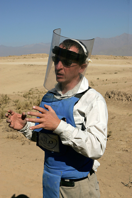 Tom Dibb is Halo Trust's Afghanistan Operations Manager. Afghanistan remains one of the most heavily mined countries in the world. A mine clearance team from the Halo Trust have been working for more than a year in the small village of Kohe Safi and have removed 800 mines and 118 unexploded bombs. Kohe Safi, Afghanistan on the 1st of November 2007..Throughout the country the Halo Trust alone is working to clear 90 million square meters of mine fields containing some 640,000 mines, they estimate it will take them 18 years to complete this task..A break through in mine detection not seen since  World War II is due to speed things up in the coming year when Halo become the first civillian organisation to use H-STAMIDS (The Handheld Stand-Off Mine Detection System) a new combination tool with a metal detector and ground penetrating radar system. The H-STAMIDS remain classified and during recent trails in Afghanistan the device had to be returned to the US military at the end of each day. The new equipment should make mine clearance 2-3 times faster.