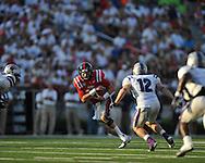 Ole Miss quarterback Bo Wallace (14) runs at Vaught-Hemingway Stadium in Oxford, Miss. on Saturday, September 1, 2012.