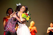 Abbey Hitchens is hugged by Rosie Westerbeck, the 2014 Miss Ohio Outstanding Teen  as she accepts her her flowers as second runner up in the pageant.