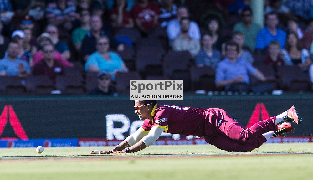 ICC Cricket World Cup 2015 Tournament Match, South Africa v West Indies, Sydney Cricket Ground; 27th February 2015<br /> West Indies Lendl Simmons tries to stop a ball on the way to the boundary