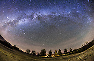 The arch of the Milky Way in the northern autumn and early winter sky, from Arizona on December 5, 2015. The Milky Way extends from Aquila to the left, in the southwest to Cassiopeia at top right, to Perseus and Auriga at far right, in the northeast. I shot this from the Quailway Cottage near Portal, Arizona, latitude +32&deg; N. The view is looking north toward the celestial pole. Polaris is just right of lower centre.<br />  <br /> This is a stack of 8 tracked exposures, each 3 minutes at f/2.8 with the 15mm lens and Canon 6D at ISO 1600, with the ground coming from one exposure to minimize blurring. The camera was on the iOptron Sky-Tracker.