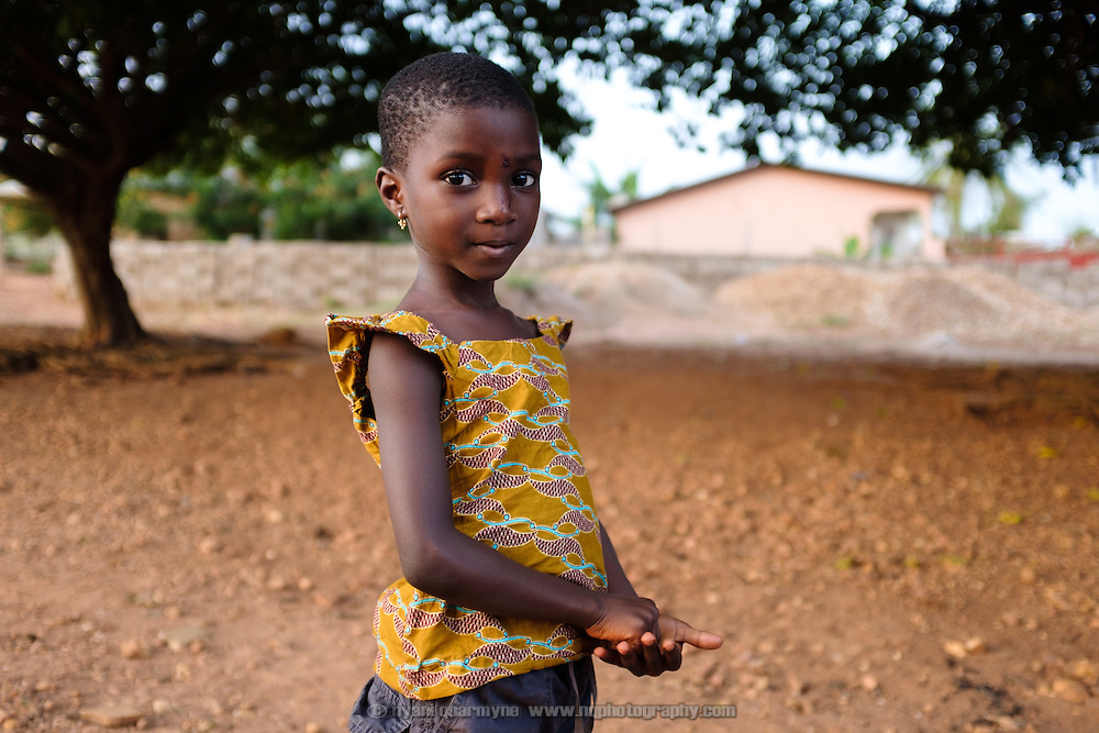 Five year-old Vera after a weekly group meeting for children run by Mama Agblatsu III, a Queen Mother in Bankoe, a traditional division in the town of Ho in the Volta Region of Ghana, during which the children learn traditional songs and games that are in danger of being lost.