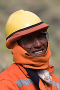 A Conirsa construction worker protected against the cold and dust on a high altitude section of the Interoceanic Highway