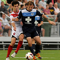 Wilmington's Cody Arnoux moves the ball past Arizona's Paolo Delpiccolo Friday July 25, 2014 at Legion Stadium in Wilmington, N.C. (Jason A. Frizzelle)