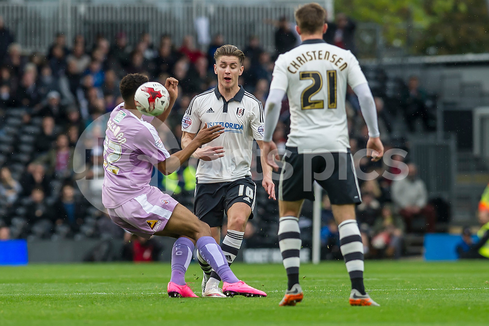 Tom Cairney of Fulham and Nick Blackman of Reading challenge for the ball during the Sky Bet Championship match between Fulham and Reading at Craven Cottage, London, England on 24 October 2015. Photo by Salvio Calabrese.