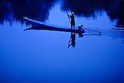 16 MARCH 2009 -- VANG VIENG, LAOS: A man poles his small boat in the twilight down the Nam Xong River in Vang Vieng, Laos.  Photo by Jack Kurtz