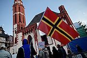 Frankfurt am Main | 30 Mar 2015<br /> <br /> Am Montag (30.03.2015) demonstrierten etwa 40 Menschen unter dem Namen &quot;Freie B&uuml;rger f&uuml;r Deutschland&quot; auf dem R&ouml;merberg in Frankfurt am Main gegen Islamisierung und zahlreiche andere &Uuml;bel, die Gruppe war zuvor unter dem Namen &quot;PEGIDA&quot; aufgetreten. Etwa 600 Menschen protestierten lautstark gegen diese Kundgebung.<br /> Hier: &quot;Freie B&uuml;rger f&uuml;r Deutschland&quot;-Demonstrant mit einer Fahne der GDL (German Defence League).<br /> <br /> &copy;peter-juelich.com<br /> <br /> [No Model Release | No Property Release]