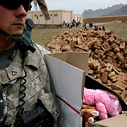 Soldiers of the 2nd platoon of the 10th mountain division give away toys and school materials to schools and kids in Charkh district in Logar province, Afghanistan on Saturday, May 9th 2009...Photo: Guilad Kahn.