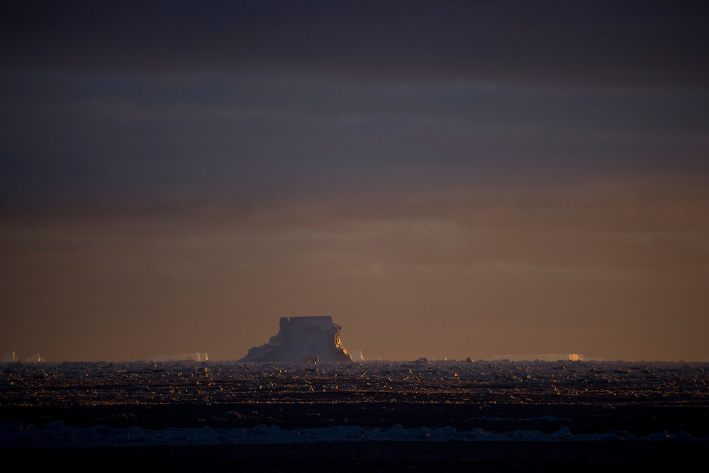 February 13th 2007. Southern Ocean. Icebergs float through the sea ice of the Ross Sea.