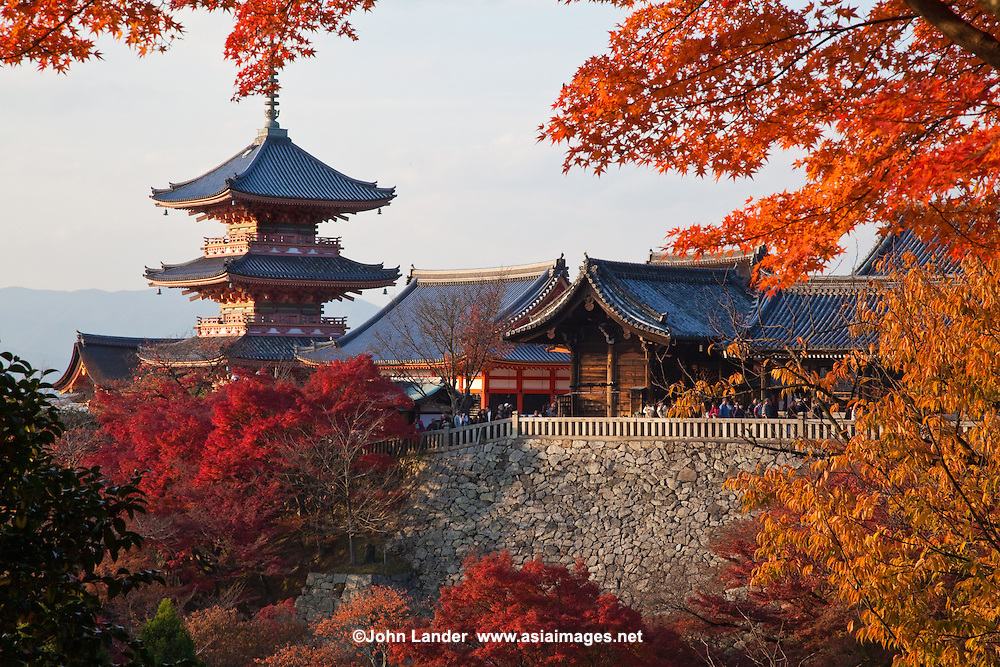 Kiyomizu Temple in Autumn; Kiyomizu-dera is a Buddhist temple in Kyoto, a major attraction to the city and a UNESCO World Heritage site.  Not one nail was used in building the entire temple.  It takes its name from the waterfall in the hills nearby, the water itself being sacred -  In Japanese Kiyomizu means clear water or pure water.