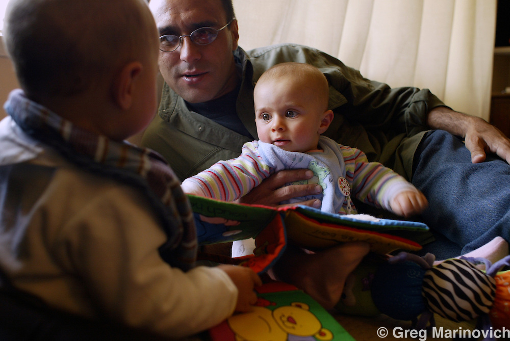 Joao Silva with his daughter Isabel and Greg's son Luc. Johannesburg. 03/07/2005