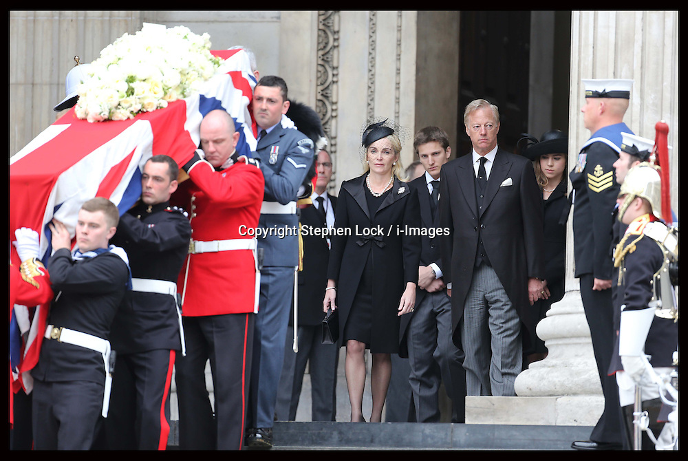 Baroness Thatcher's family behind her coffin as it's leaves  St.Paul's Cathedral in London , Wednesday 17th  April 2013 Photo by: Stephen Lock / i-Images