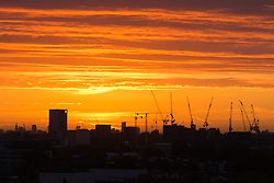 Primrose Hill, London, September 27th 2016. Distant tower cranes break the skyline, viewed from Primrose Hill as dawn breaks over London. &copy;Paul Davey<br /> FOR LICENCING CONTACT: Paul Davey +44 (0) 7966 016 296 paul@pauldaveycreative.co.uk