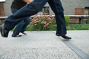 High Line Manhattan West Side New York City USA..New York has a new park. The elevated High Line was built for freight trains in the 1930s. The group 'Friends of the High Line' saved it from being demolished and created an unusual public park on its elevated tracks. It is located on Manhattan's West Side. It runs from Gansevoort Street in the Meatpacking District to 34th Street, between 10th & 11th Avenues. Section 1 of the High Line, which opened to the public on June 9 2009, runs from Gansevoort Street to 20th Street. It features an integrated landscape, designed by landscape architects James Corner Field Operations, with architects Diller Scofidio + Renfro..New York hat einen neuen Park. Die erhoehte Schienenstrasse wurde in den 30ger Jahren fuer Lastzuege gebaut. Die Gruppe 'Freunde der High Line' hat sie nun vom Abriss bewahrt und mit Unterstuetzung der Stadt New York einen Park in luftiger Hoehe erschaffen. Er befindet sich auf Manhattans West Seite und verlaeuft von der Gansevoort Strasse im Meatpacking District zur 34ten Strasse zwischen der 10the und 11ten Avenue. Der Park wurde teilweise am 9. Juni 2009 eroeffnet. Seine integrierte Landschaft wurde von dem Landschaftsarchitektur Buero James Corner Field Operations mit den Architekten Diller Scofidio + Renfro gestaltet.