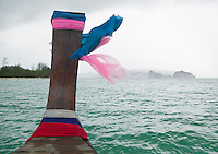 Bow of a long-tail boat heading toward land on a rainy windy day in Southern Thailand during monsoon season&amp;#xA;<br />