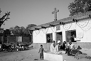 A Christian family is sitting outside a protestant church on the edge of the French colony slum in the city center of Islamabad.