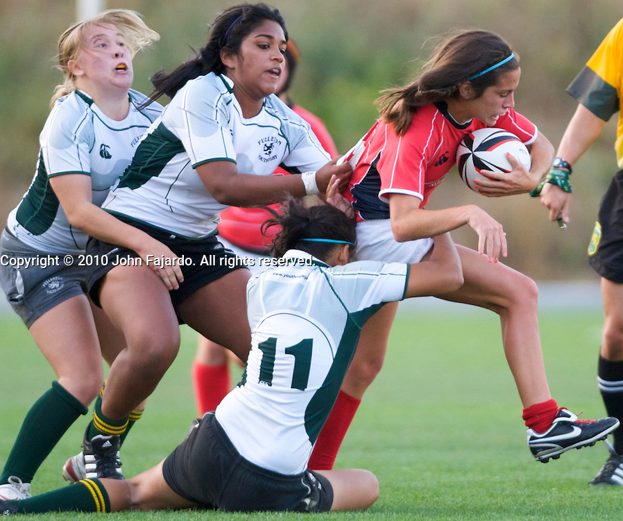 Fallbrook(Red) takes on Fullerton Youth Rugby(Green) for the girls U19 Southern California Youth Rugby Championship at Titan Stadium, Fullerton, Calif., Saturday, May 8, 2010.  Fallbrook wins 22-0 earning a berth in the USA Rugby National Championship Tournament.