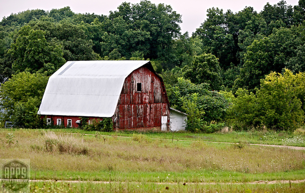 A collection of Barns that still can be seen while traveling the countryside in  the beautiful State of Wisconsin.<br /> Crawford County- Barn County Rd X and Adams Road. Barns from around the State of Wisconsin.