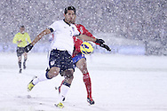 March 22nd, 2013 Commerce City, CO - As the snow falls harder, U.S. National Soccer defender Omar Gonzalez (3) attempts to clear the ball out of the goal box during the second half of the World Cup qualifying match between Costa Rica and the USA Men's National Team at Dick's Sporting Goods Park in Commerce City, CO