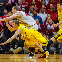 BLOOMINGTON, IN -- February 3, 2013 -- University of Michigan guard Nik Stauskas battles Indiana University forward Cody Zeller at Assembly Hall in Bloomington during their loss to the Hoosiers.  (PHOTO / CHIP LITHERLAND)