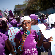 Women from Haitian Women's Solidarity (SOFA) lead protestors in chanting and singing as they march. (Photo by Ben Depp)