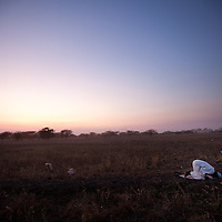 A man prays at dusk near South Sudan's richest oli deposit.
