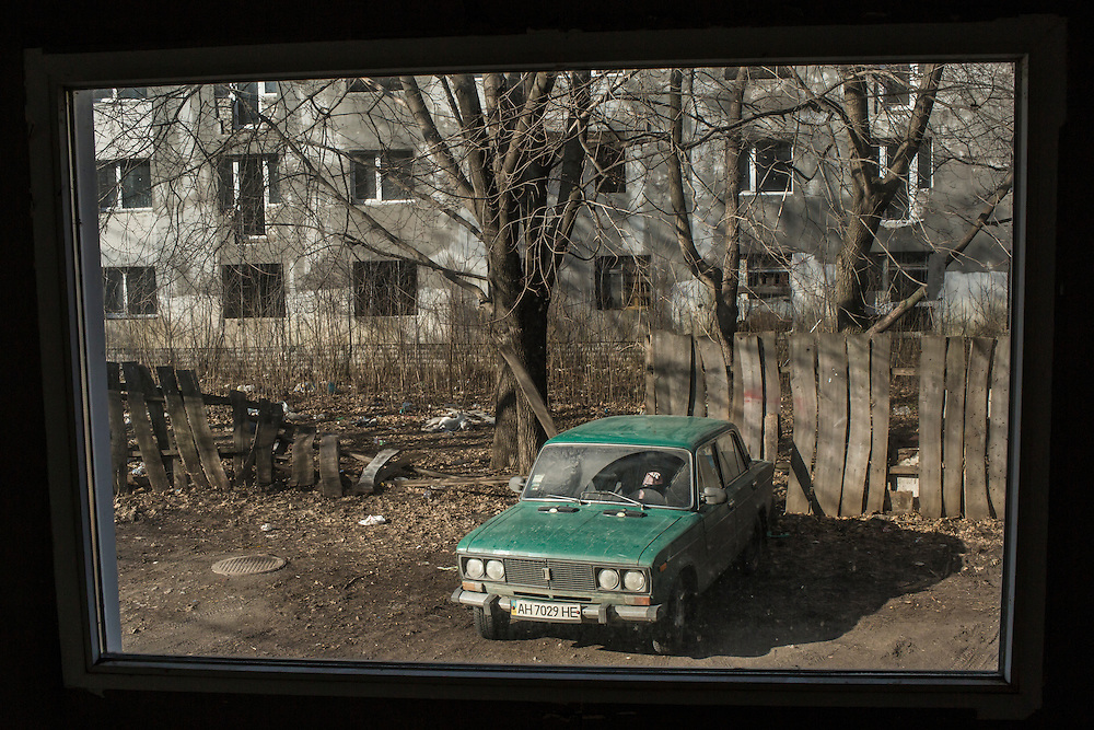 A greed Lada, seen through a window on Friday, February 12, 2016 in Slovyansk, Ukraine.