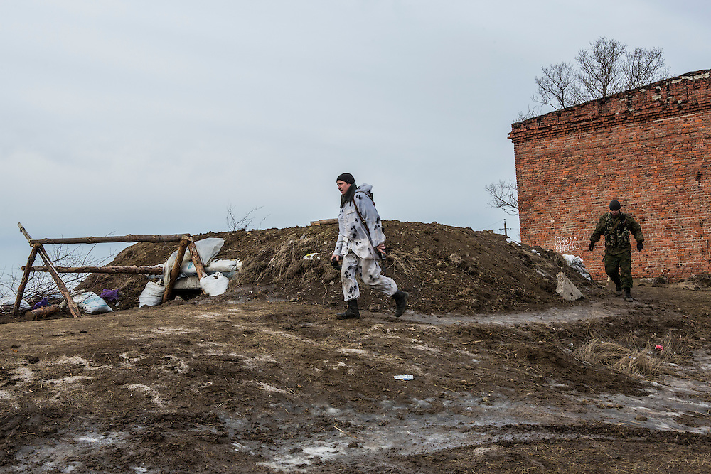 GORLOVKA, UKRAINE - JANUARY 31, 2015: Rebel fighters move along a front-line position in Gorlovka, Ukraine. Fighting in Ukraine has intensified over the last week, with rebels declaring the end of a September ceasefire. CREDIT: Brendan Hoffman for The New York Times