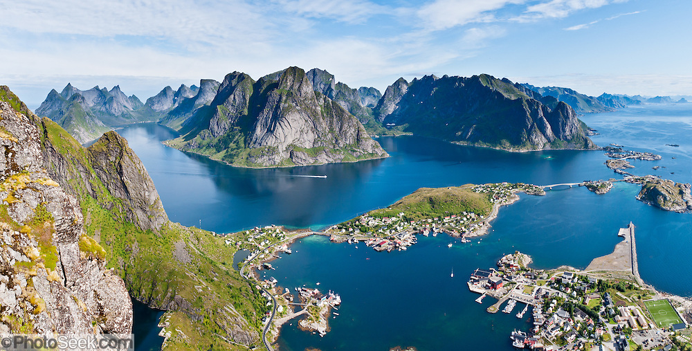 Above the Arctic Circle, ascend a slippery steep trail to Reinebringen for spectacular views of sharply glaciated peaks surrounding Reinefjord, on Moskenesøya (the Moskenes Island), Lofoten archipelago, Nordland county, Norway. Panorama stitched from 2 overlapping photos.