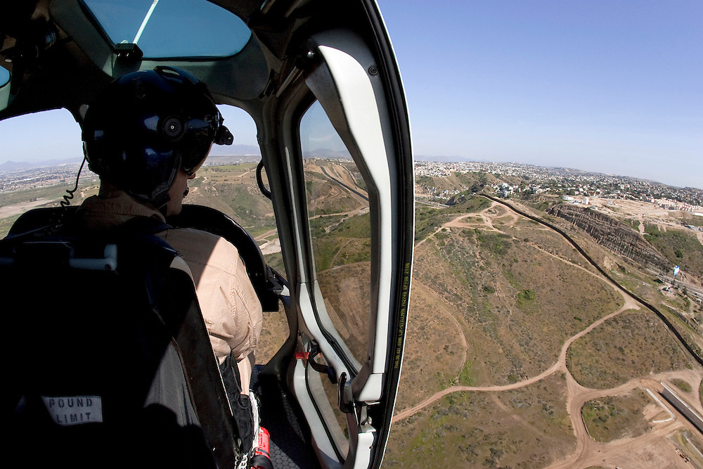 "Adam Polak, Customs and Border Protection agent with the Air and Marine division, patrols the shoreline along the U.S/Mexico border in San Diego, California. For more images, search for ""immigration by air and sea"". Please contact Todd Bigelow directly with your licensing requests."