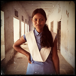 iPhone portrait of Sunita Bairwa, 18, in a village outside of Tonk, Rajasthan, India, April 3, 2013. &quot;I told my father, &lsquo;Papa don&rsquo;t get me married, I will study.&rsquo; Dad said, &lsquo;No I will get you married.&rsquo; Then the teacher went and talked to my father, scolded my father, and then my father understood somehow. He said, &lsquo;OK, we&rsquo;ll not get her married and we&rsquo;ll listen to you.&rsquo; &rdquo; said Bairwa.<br /> <br /> Under Indian law, children younger than 18 cannot marry. Yet in a number of India&rsquo;s states, at least half of all girls are married before they turn 18, according to statistics gathered in 2012 by the United Nations Population Fund (UNFPA). However, young girls in the Indian state of Rajasthan&mdash;and even a few boys&mdash;are getting some help in combatting child marriage. In villages throughout Tonk, Jaipur and Banswara districts, the Center for Unfolding Learning Potential, or CULP, uses its Pehchan Project to reach out to girls, generally between the ages of 9 and 14, who either left school early or never went at all. The education and confidence-building CULP offers have empowered young people to refuse forced marriages in favor of continuing their studies, and the nongovernmental organization has provided them with resources and advocates in their fight.